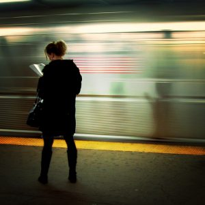 reading on train platform